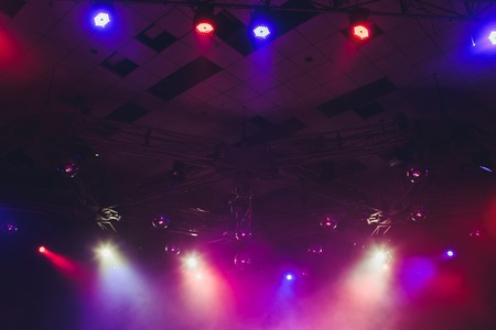 Lighting equipment on an empty stage. Red and blue.