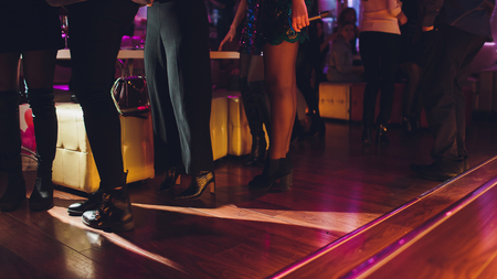 Legs of dancing people at the party. Stock Photo