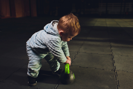 Healthy lifestyle child exercising dumbbell weight sport.
