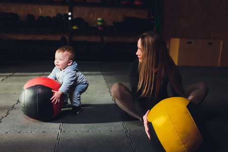 Woman as a therapist at physiotherapy and sports with child in gym.