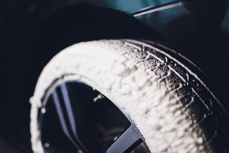 Car Care or Car Detailing Process. Using black sponge to washing the tire. blacker rubber. Reklamní fotografie