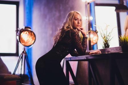 beautiful woman model posing in elegant dress on the studio background. Banco de Imagens
