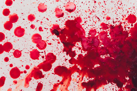 Fresh human bright red blood on floor. Stock Photo