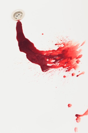 Blood draining from white bathroom basin. Bloody stains in the waterbasin hole. Sink run with blood floods. Red paint dripples to the washbowl drain. Accident with human injury. Bleeding in bathroom. Standard-Bild