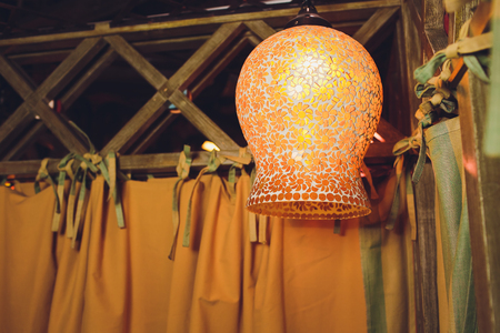 An old beautiful lamp in gazebo at night.