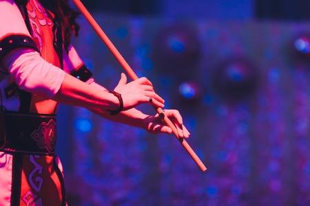 Man in national costume play national music instrument. kurai.