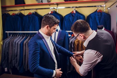 man is buying suit in store Reklamní fotografie