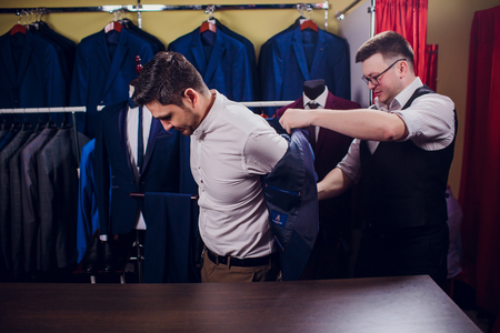 man is buying suit in store 스톡 콘텐츠