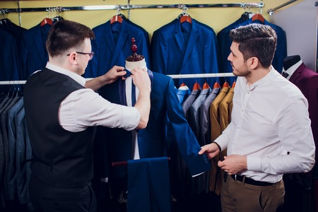 man is buying suit in store Фото со стока - 121333709
