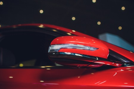 Close up side mirror on sports car