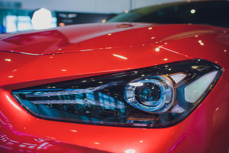 Headlights and hood sport red car with silver stars Imagens