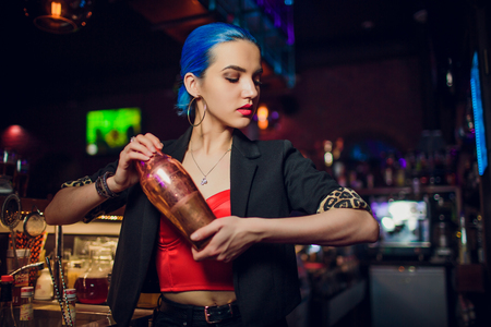girl bartender makes a cocktail Stock Photo