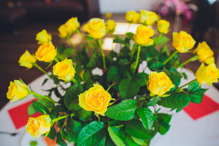 Yellow roses in vase on the table