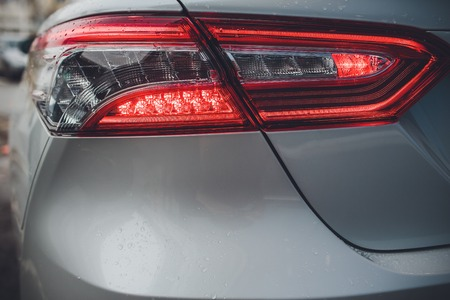 taillight with brilliant reflections auto white body.