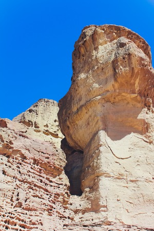 Timna Park and Solomon Pillars, Rocks in the desert, Landscape in the desert. Small rocky hills. Stone desert, red desert, sunny day, high mountains, hot, Timna Park, panorama.