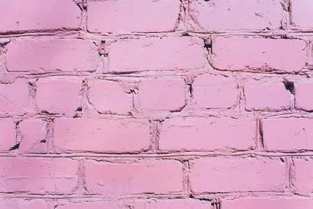 Beautiful pink purple brick wall with white grout, colorful background, abstract texture for copy space