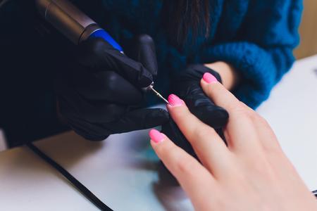 Close up of process france manicure at beauty salon