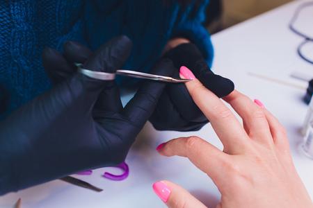 Close up of process france manicure at beauty salon Imagens - 121658758