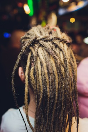 Young woman with gray braids long hair. Stock Photo