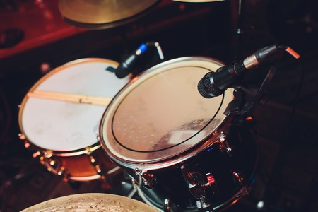 Drum kit on stage in the spotlight color. Stock Photo