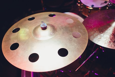 Drum kit on stage in the spotlight color. Imagens