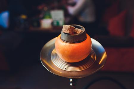 Stylish hookah with aroma grapefruit for relax. grapefruit shisha. Hookah lounge. Imagens