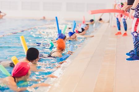 women trains in aqua aerobics, learn to swim