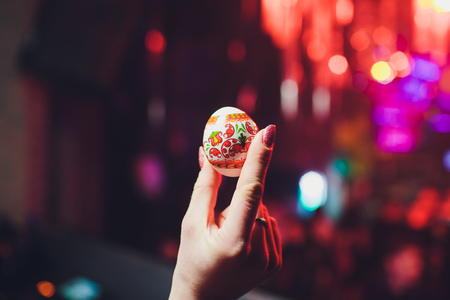 hands holding easter eggs, isolated on on the background of the club.