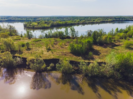 Field and river in summer, shooting from a quadcopter