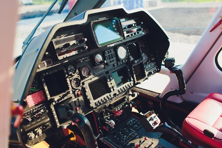 Black control panel in a helicopter cockpit.