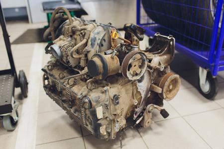 an old outdated engine, a closeup shot, engine car broken