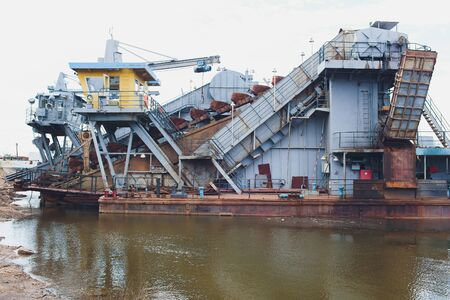 Dredger for absorption of trailer bunker during work on land reclamation for new ports. Suction dredge. Dredging in fairway of River. Cutter suction dredgers when working on land reclamation. 版權商用圖片