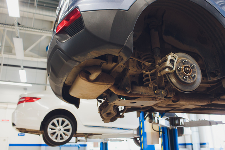 Car raised on car lift in autoservice