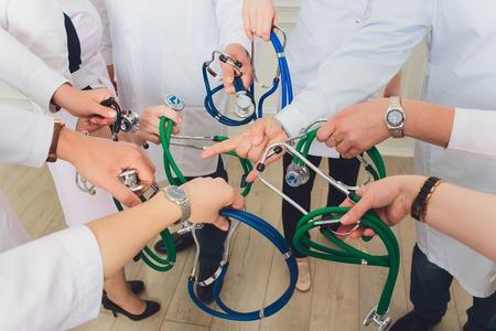 hand holding stethoscope on white background. medical group 스톡 콘텐츠