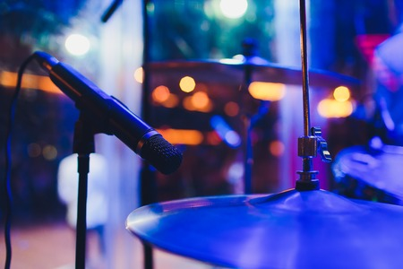Drum kit on stage in the spotlight color Imagens - 124644668