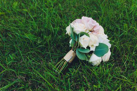 Bouquet of flowers. The brides bouquet. Bridal bouquet. Floristics. Wedding rings. Wedding bouquet from different colors. 版權商用圖片