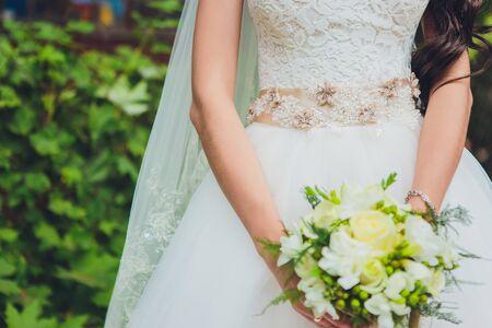 Beautiful wedding bouquet of flowers in the hands of the bride. 写真素材
