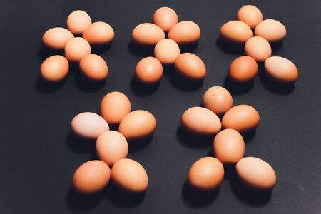 Many eggs lie together on each other, brown eggs, a lot of chicken eggs. in the shape of a man Reklamní fotografie