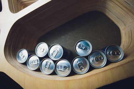 Money cans Aluminum along with Easy Open Can Lid on the shelve and in the light.