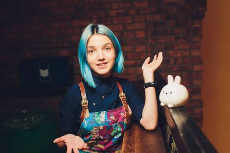 Portrait of beautiful girl with blue hair.