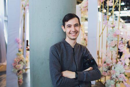 Portrait of male florist at his flower shop.