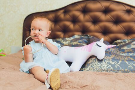 the happy little baby girl in white dress smile indoor. Stock Photo