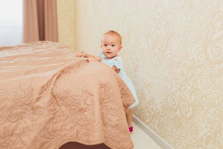 the happy little baby girl in white dress smile indoor. 写真素材