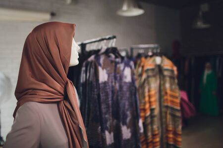 traditional muslim women dresses on display in a retail shop for the Middle East fashion.