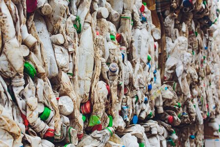 Plastic bales of tetra pak juice packages at waste processing plant. Concept of separate garbage collection and reuse.