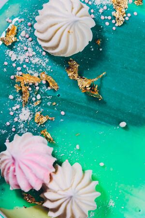 Modern French mousse cake with green mirror glaze. Picture for a menu or a confectionery catalog. Reklamní fotografie