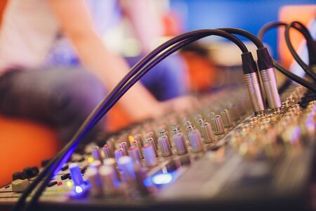 Mixing console for sound producer. Music. Sound. Sound controller. Directors remote.