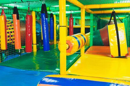 Modern playground indoor. Kids jungle in a play room. Round tunnel in children gym.