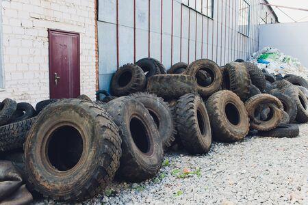 Ufa, Russia, 1 July, 2019: A lot of Wheel Tires dumped in a landfill.