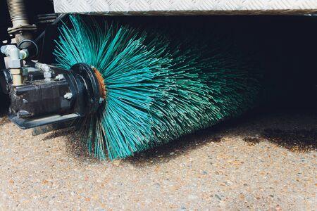 Close up shot of a road brush sweeping machine. Foto de archivo